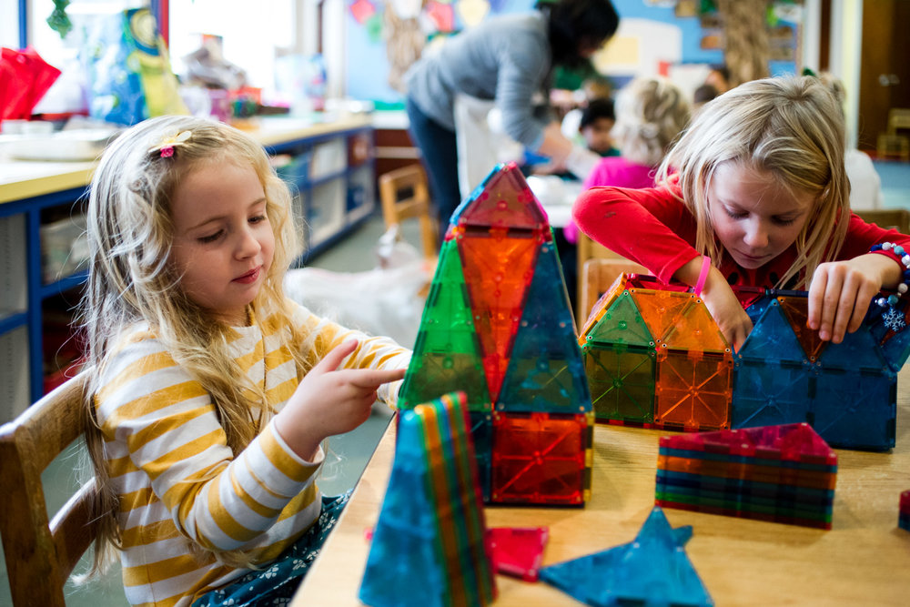 Preschool kids playing with magna-tiles.