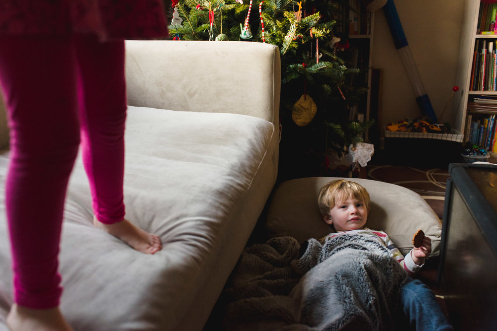 Kids playing with the couch cushions.
