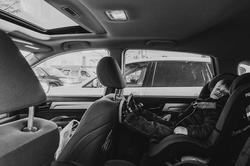 Little boy in his car seat.