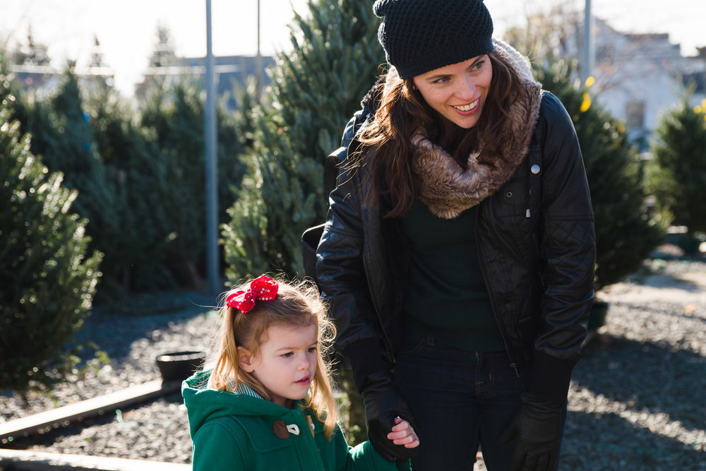 Mother and daughter at a Christmas tree farm.
