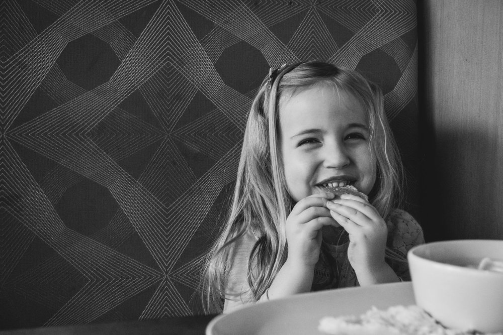 Little girl eating lunch at Panera Bread.