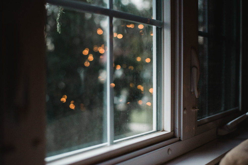 Christmas lights reflected in a window.