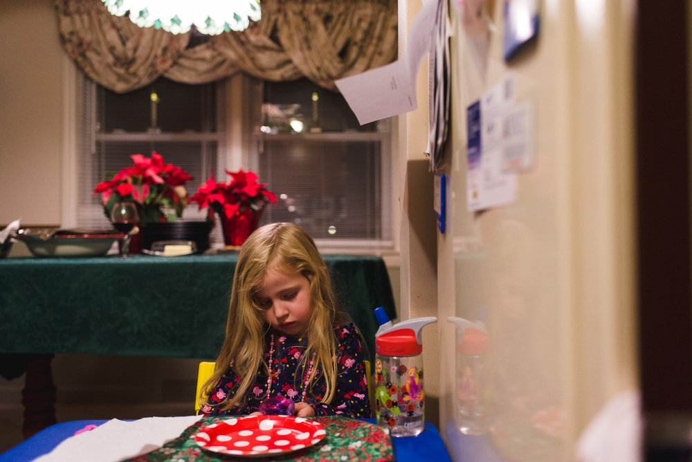 Little girl sitting at the kids' table.