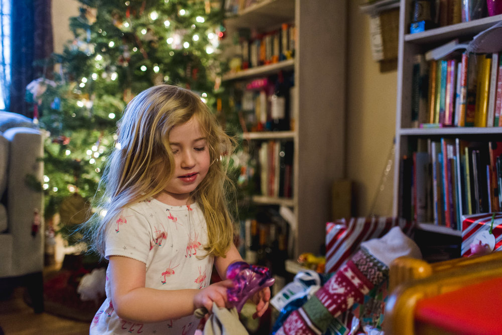 Little girl on Christmas morning.