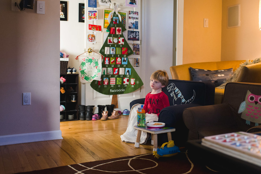 Little boy watching a movie on Christmas morning.
