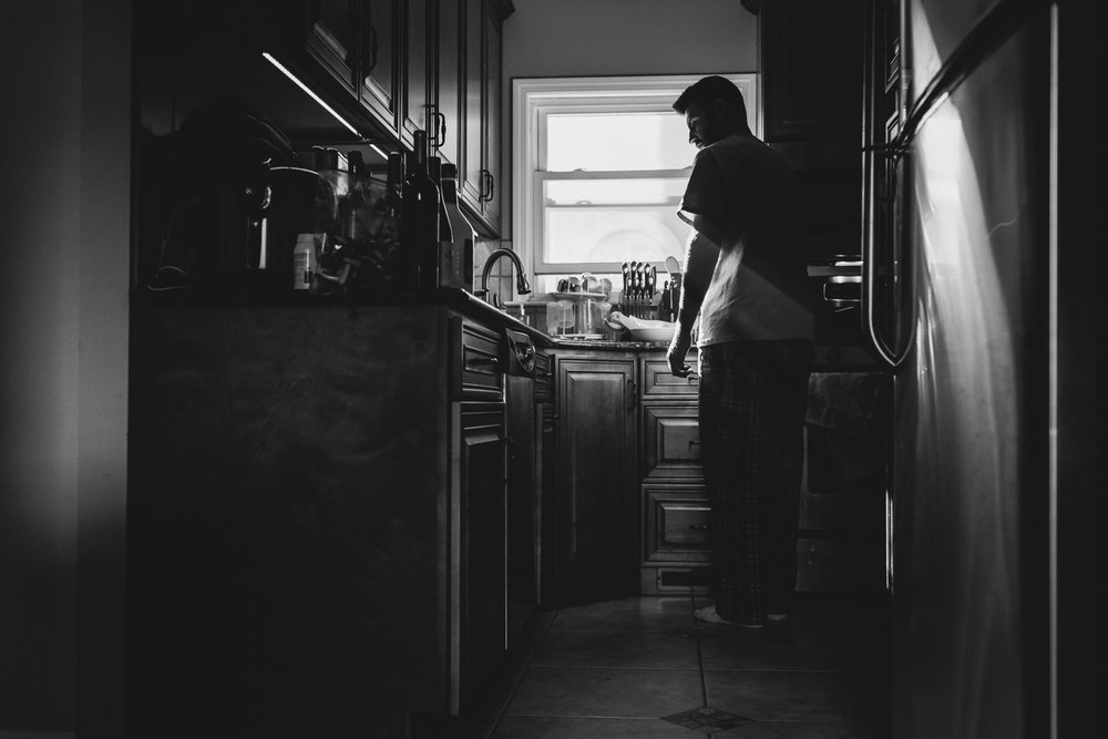 Man making breakfast in the kitchen.