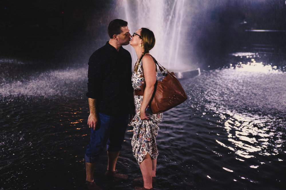 A couple kisses in the fountain in Washington Square Park.