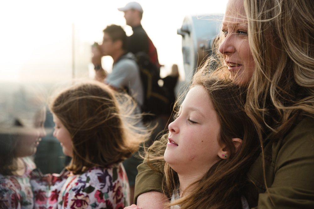 Mother embraces daughter at Top of the Rock.