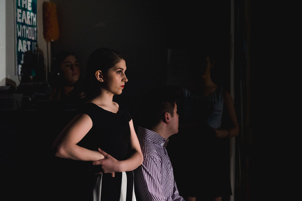 A dancer watches from the wings at Trinity High School in Hicksville.