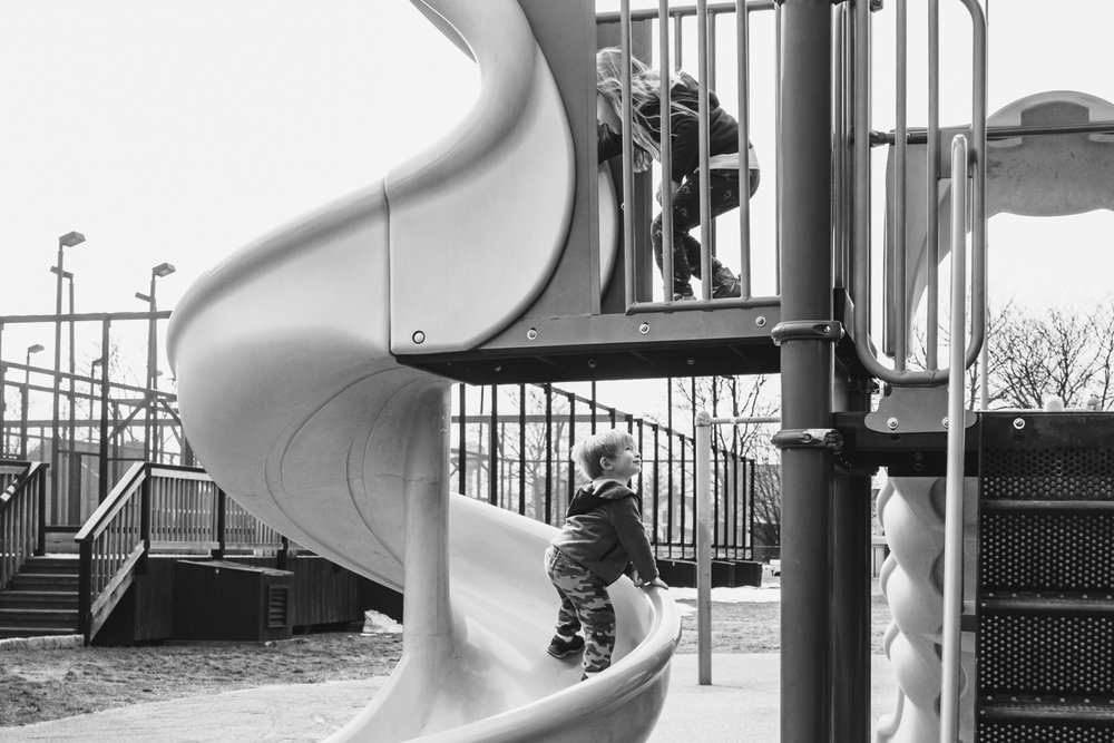 Children playing on playground structure.