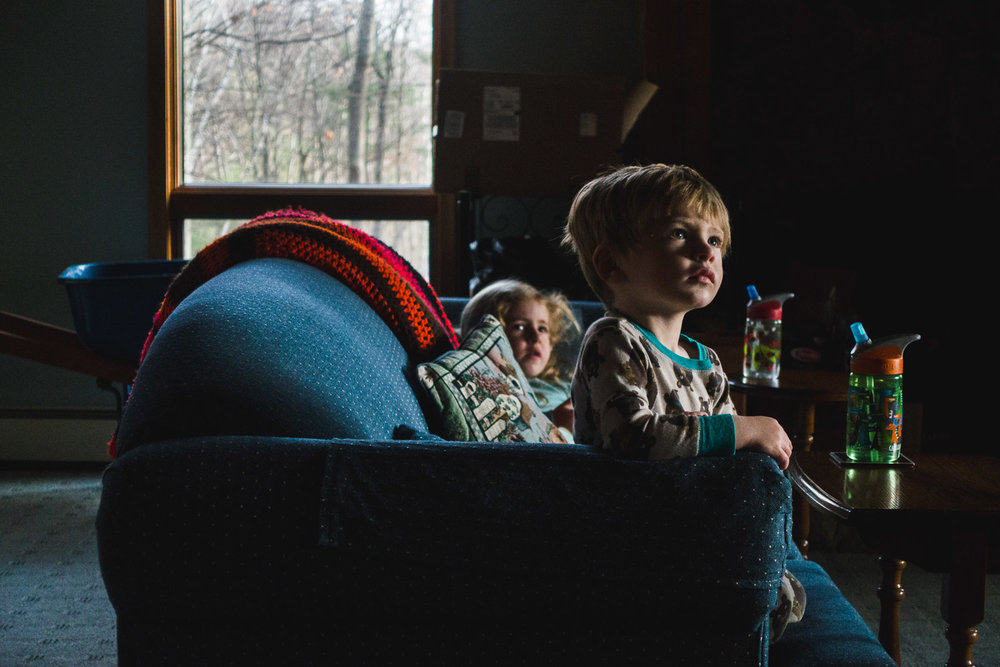 Children watching TV on the couch.