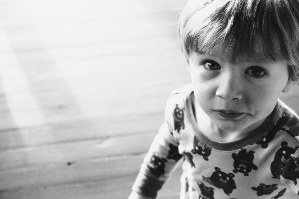 Portrait of a little boy in black and white.