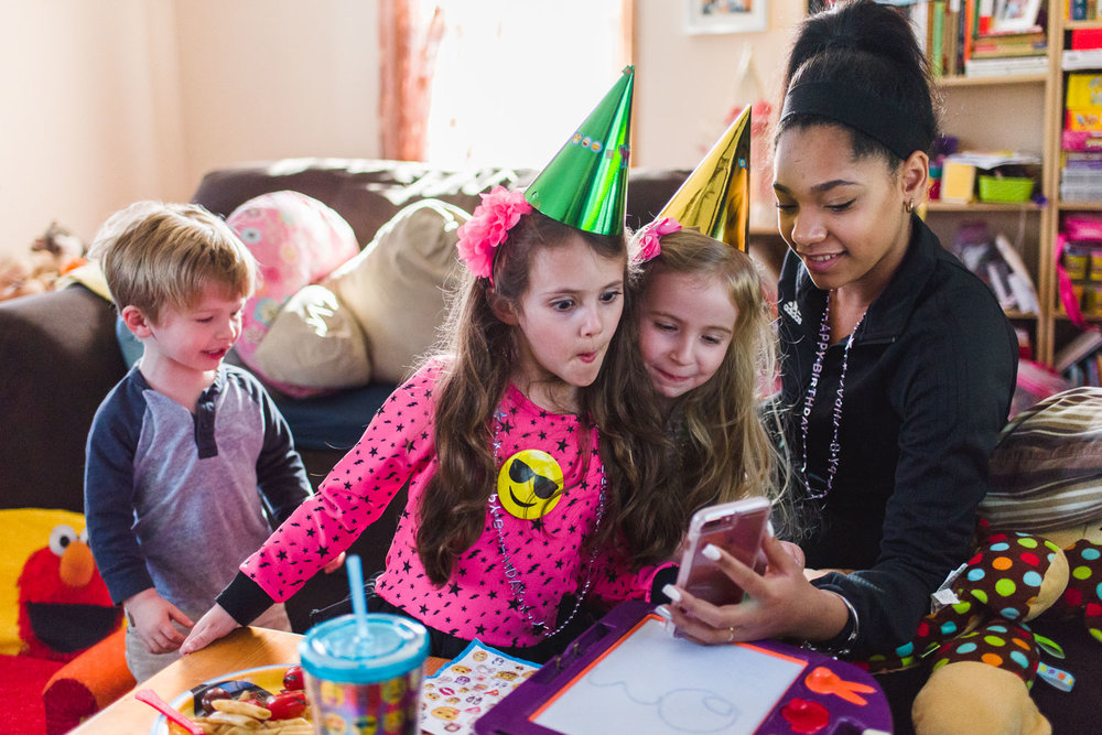 Kids play with Snapchat filters at a birthday party.
