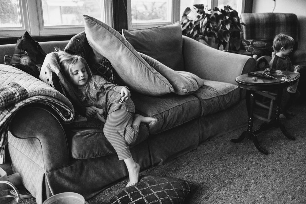 Kids lounging in messy living room.