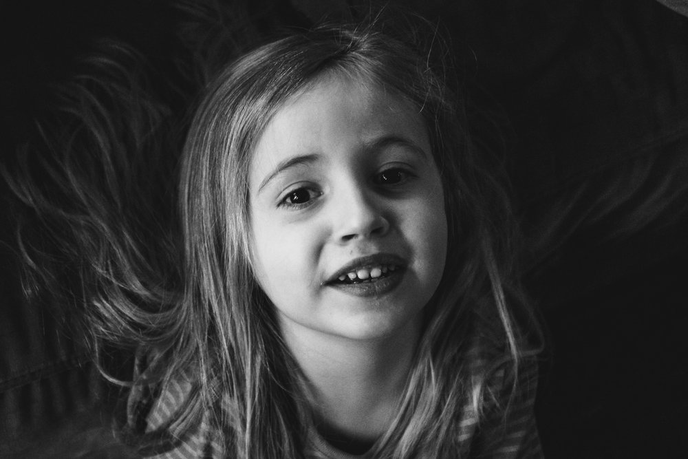 Portrait of a little girl in black and white.
