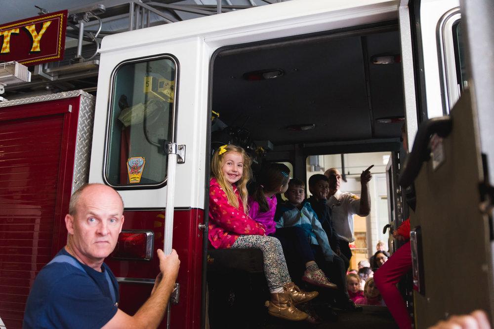 Little girl in a fire truck.