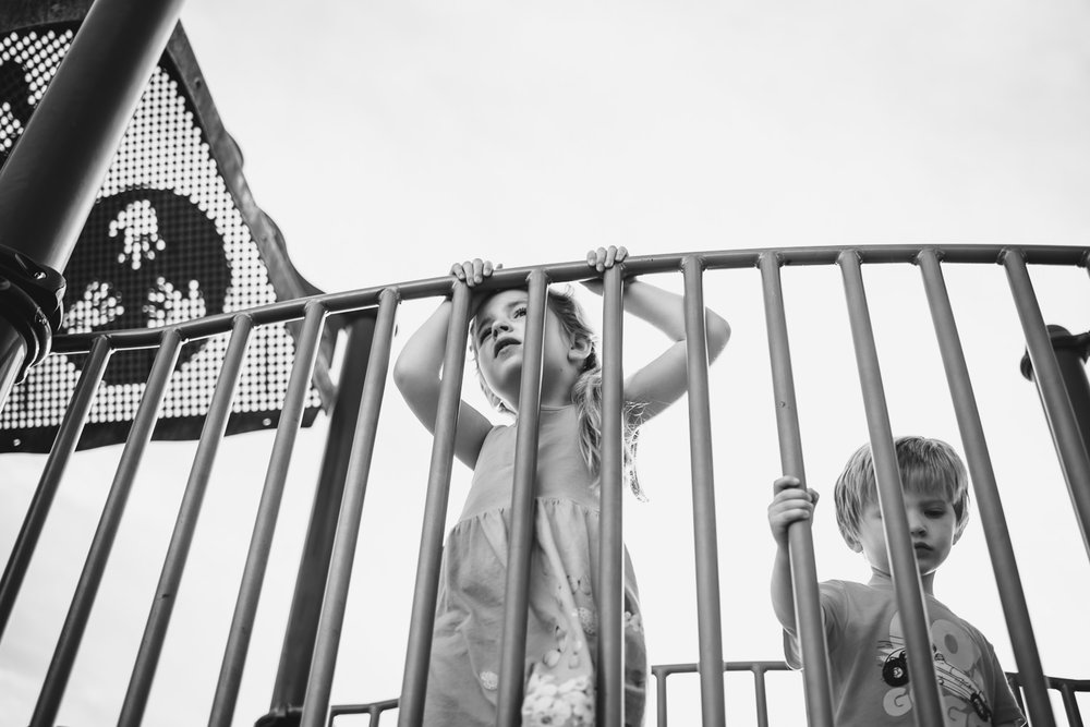 Kids play on a playground structure at Garden City Community Park.