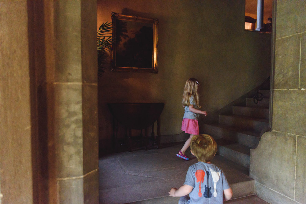 Kids climb the stairs at Coe House at Planting Fields Arboretum.