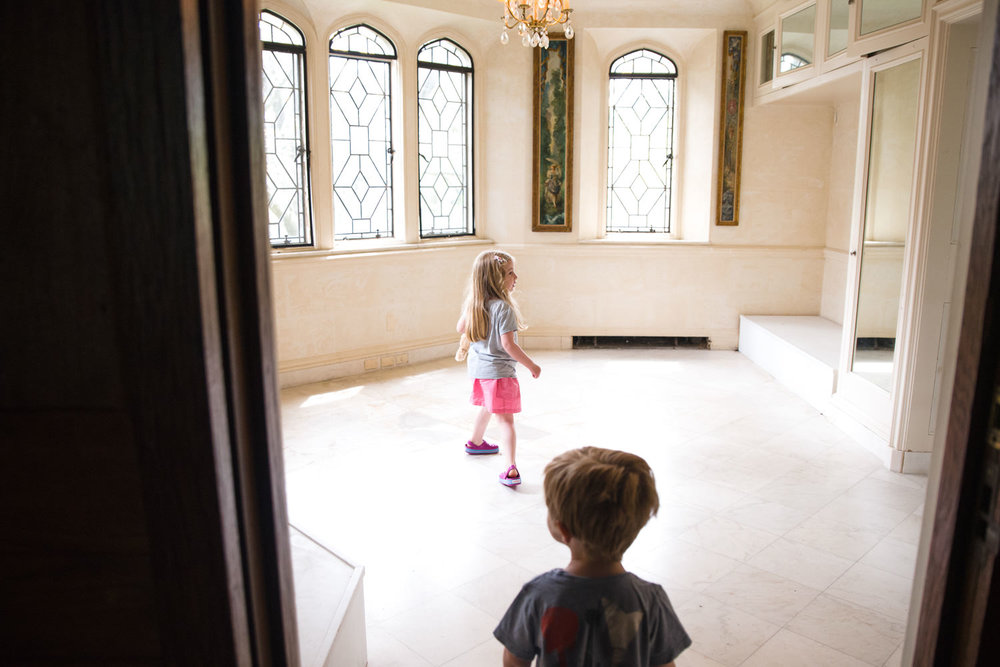 Kids explore a bathroom in Coe House at Planting Fields Arboretum.