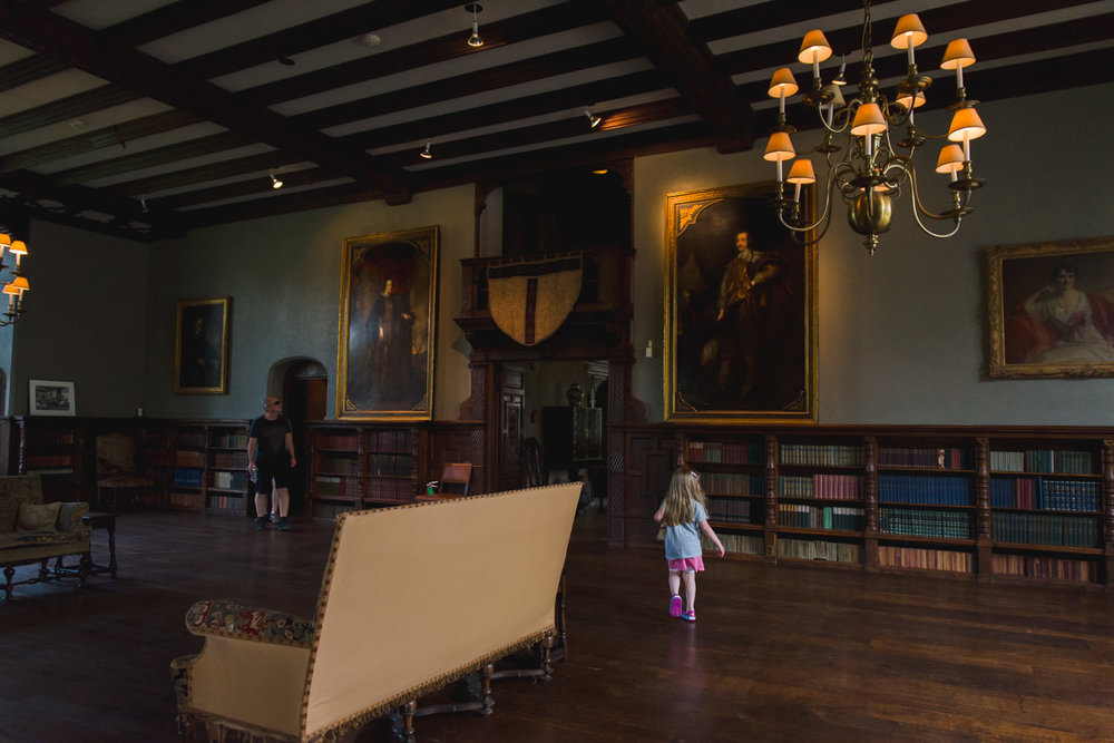 Little girl explores the library at Coe House.