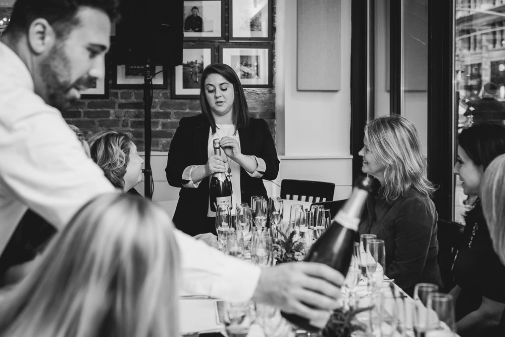 A sommelier leads a champagne tasting.