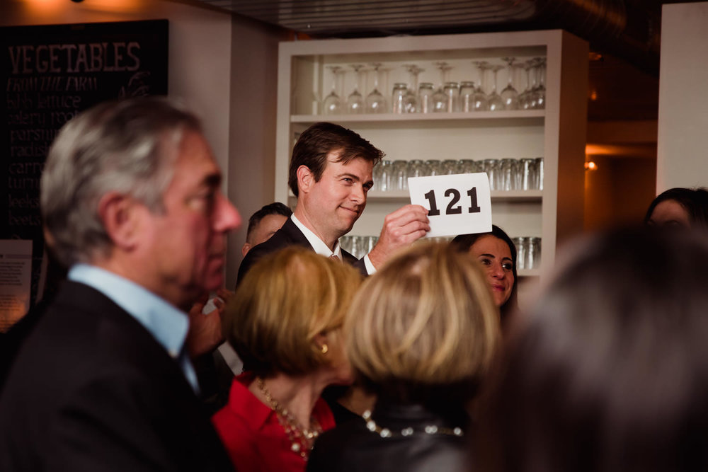 A man bids on an auction prize.