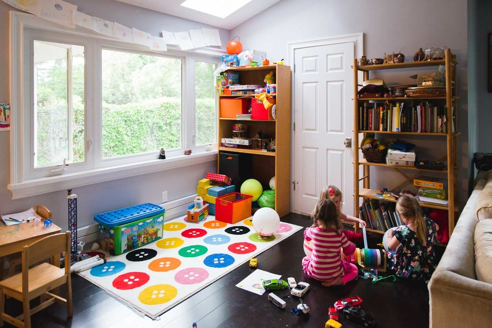 Kids play in the playroom.