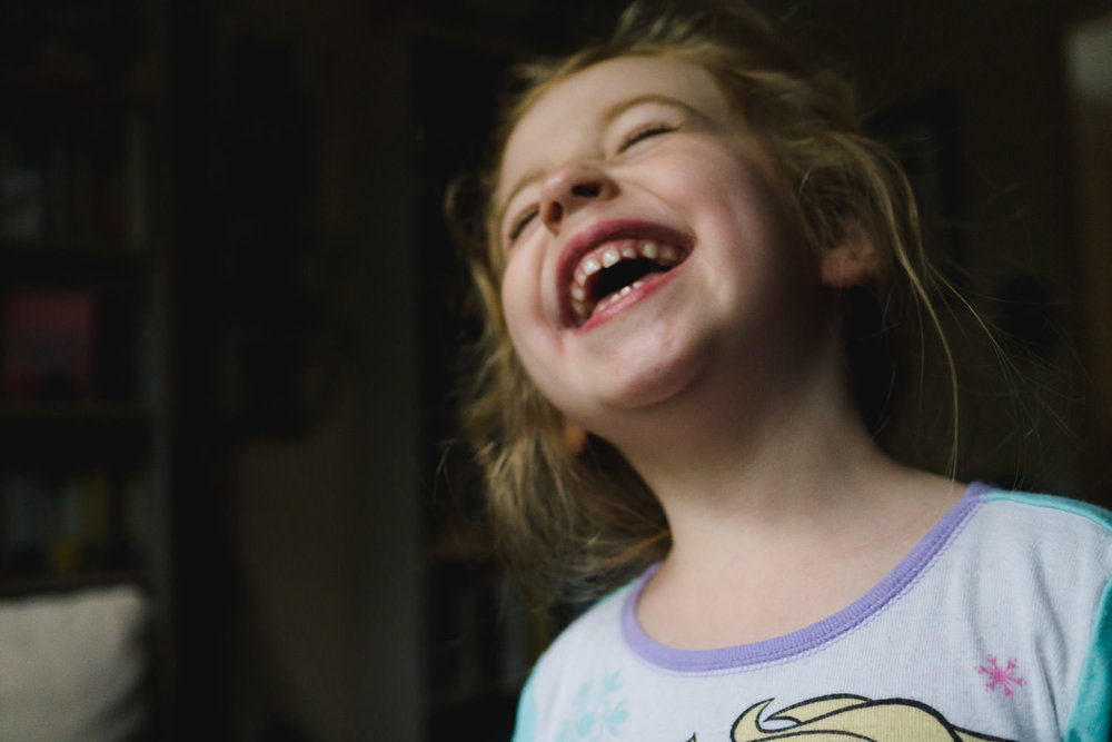Portrait of a little girl laughing