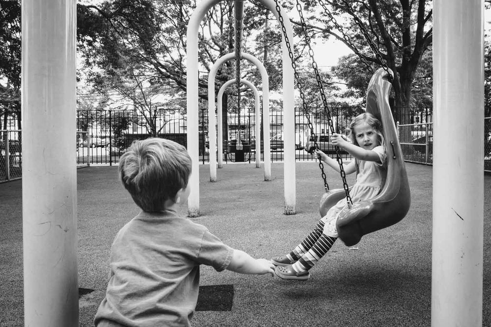 Kids fight over who gets the swing.