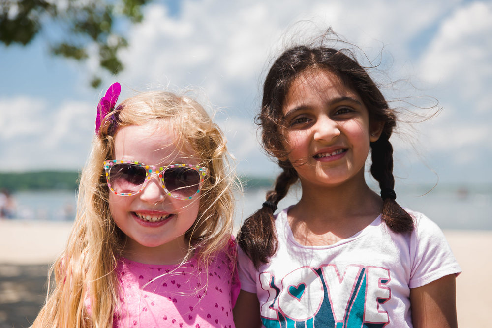 Two girls smile for the camera in Oyster Bay, NY.