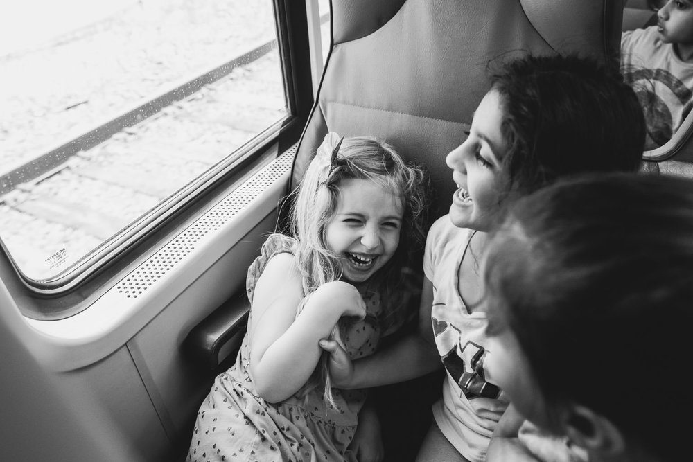 Girls have a fit of giggles on the Long Island Railroad.