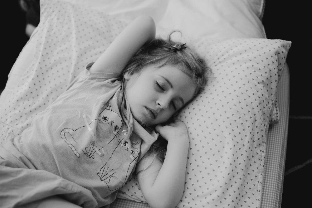 A little girl asleep.