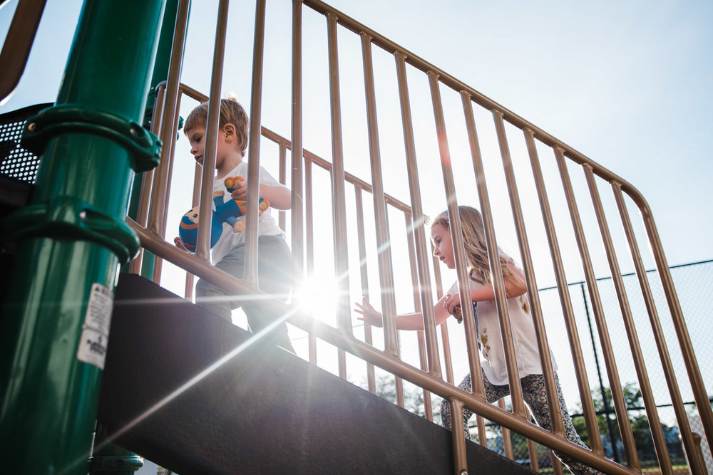 Kids climb stairs at the playground.
