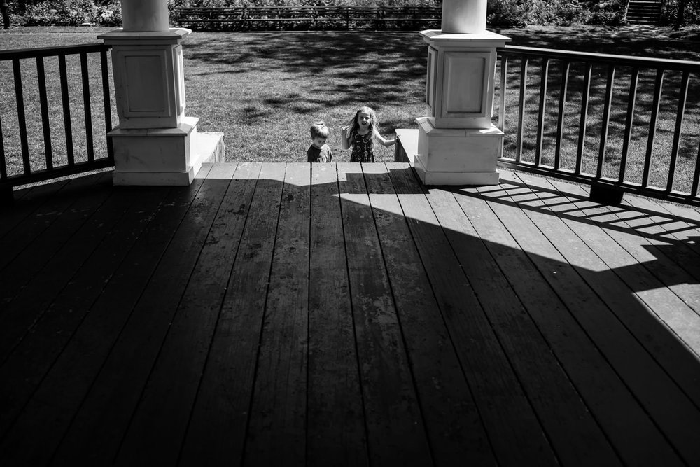 Kids play in the gazebo at Gerry Park.