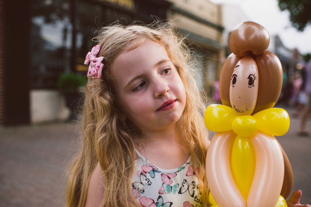 A little girl poses with her Belle balloon.