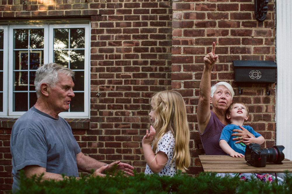 Grandparents play outside with grandchildren.