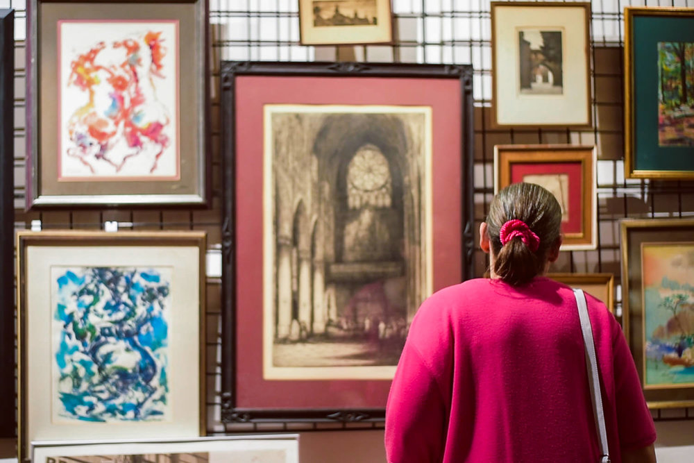 A woman looks at some art at the Project Life Center in Queens.