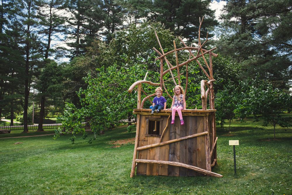 Children sit atop a playhouse at the Berkshire Botanical Gardens.