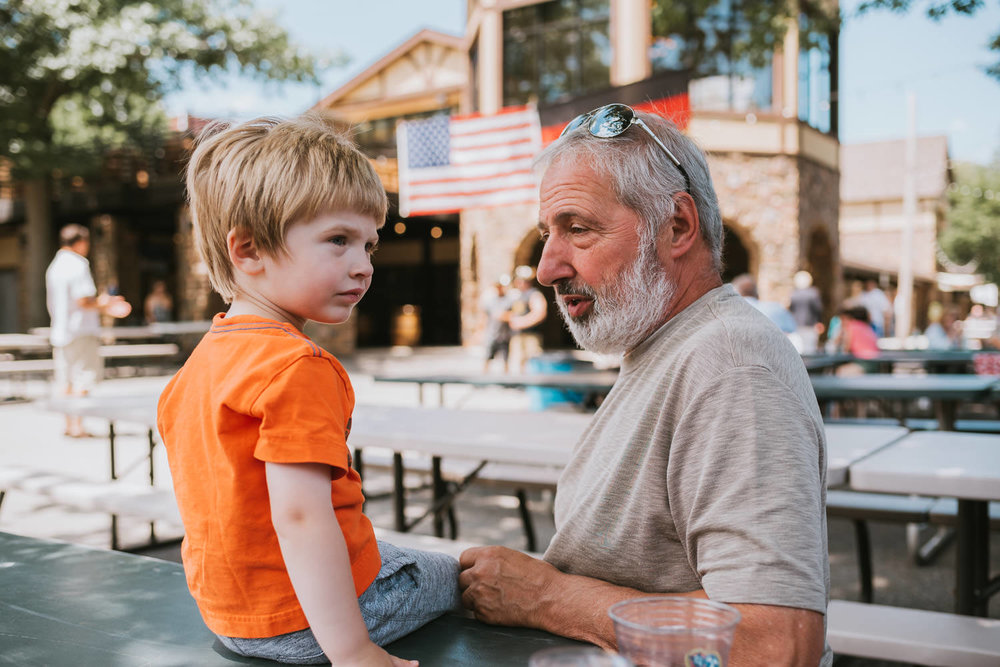 A little boy and his grandfather at the Plattdeutsche beer garden.