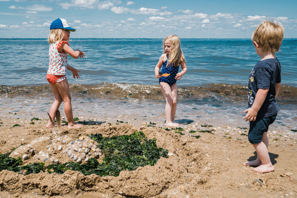 Kids build a sand castle at Sands Point Preserve.