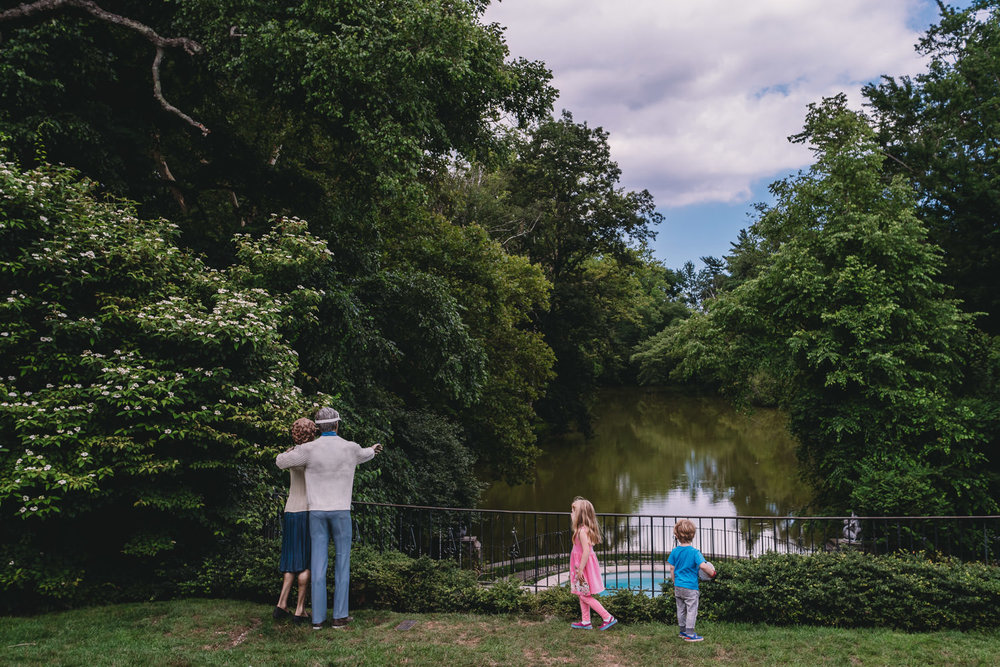 Kids look out at a pond at Old Westbury Gardens.
