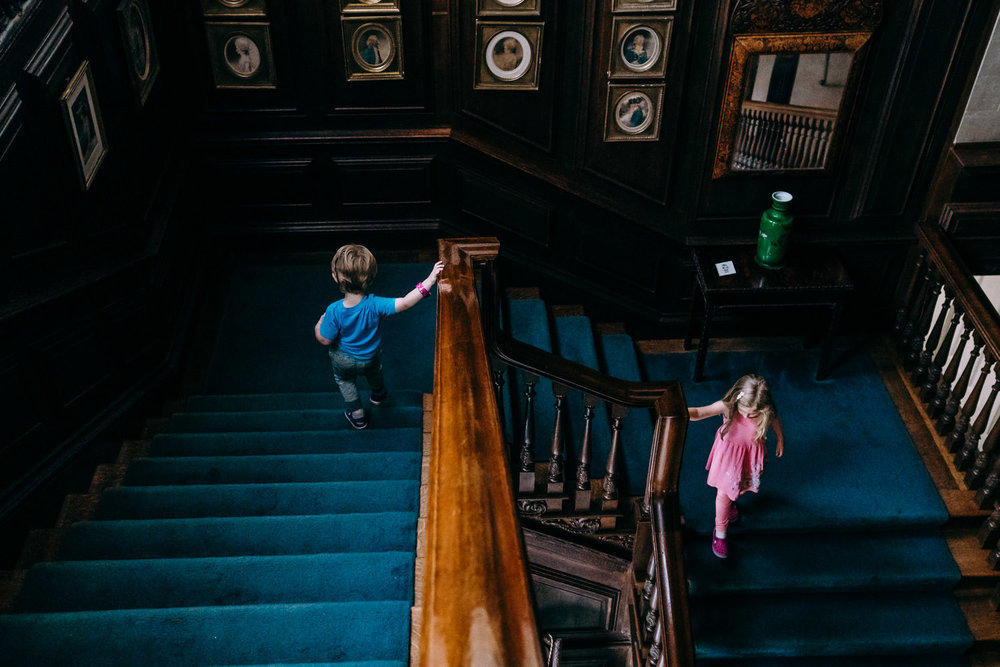 Kids climb down the stairs at Old Westbury Gardens.