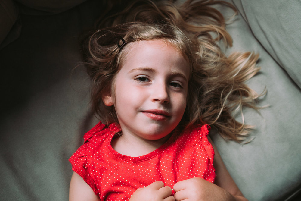A portrait of a little girl in a red dress.