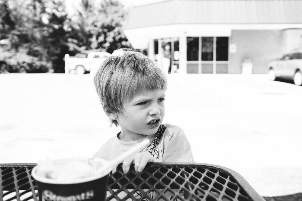 A little boy eats ice cream outside a gas station in Copake, NY.