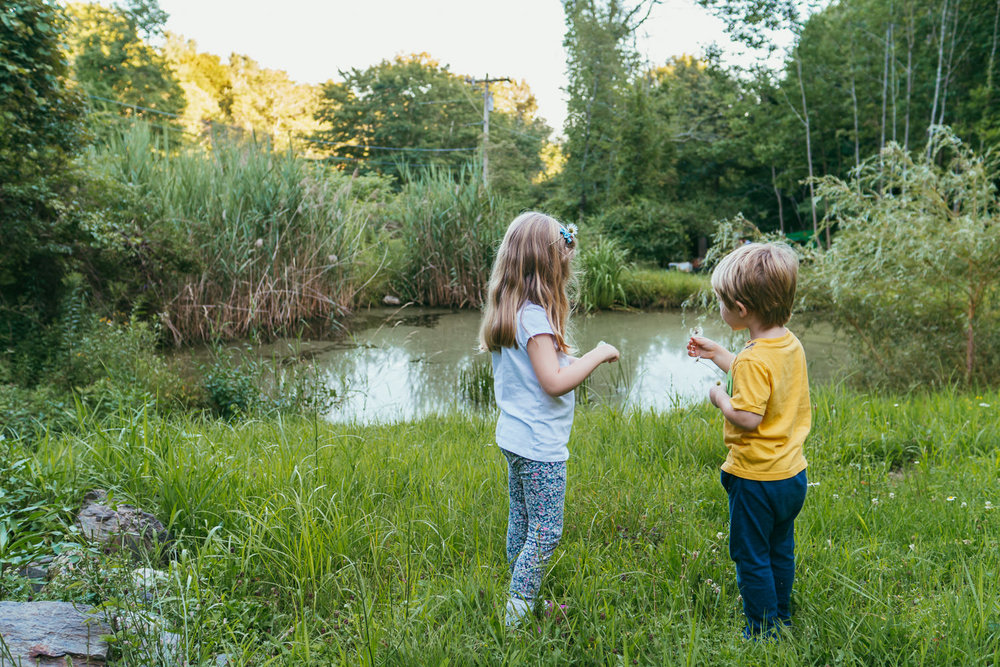 Two kids stand near a pond in Copake, NY.