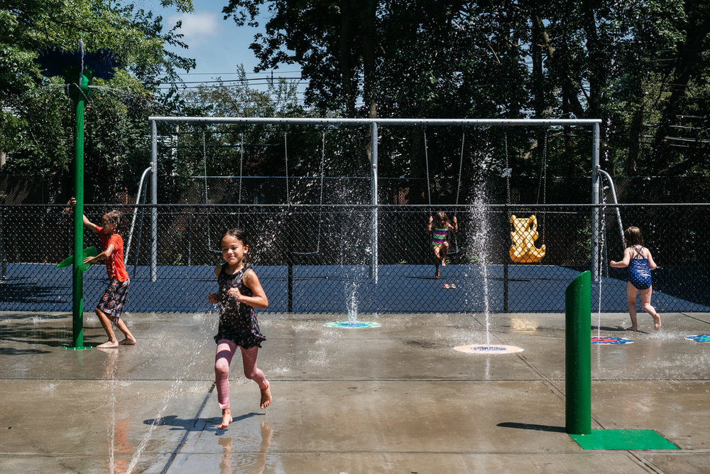 Kids play at a spray park in Rockville Center