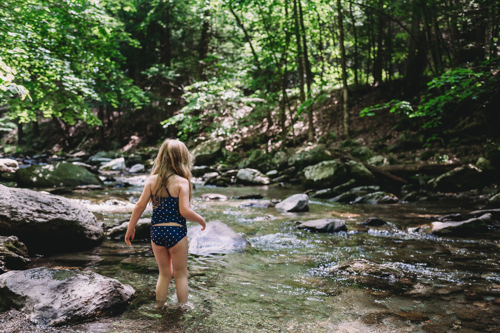 A little girl wades into the waters at Bash Bish Falls.