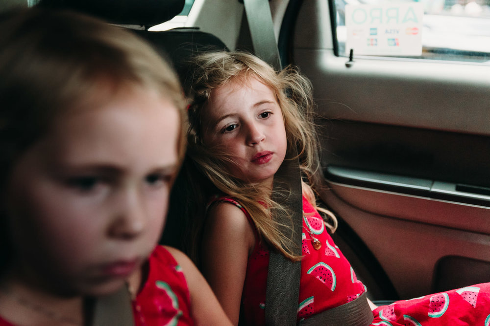 Two little girls ride in a NYC taxi.
