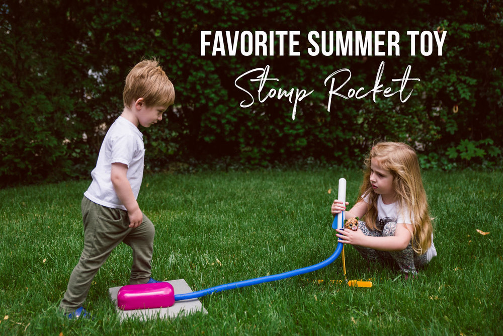 Kids play with a stomp rocket.
