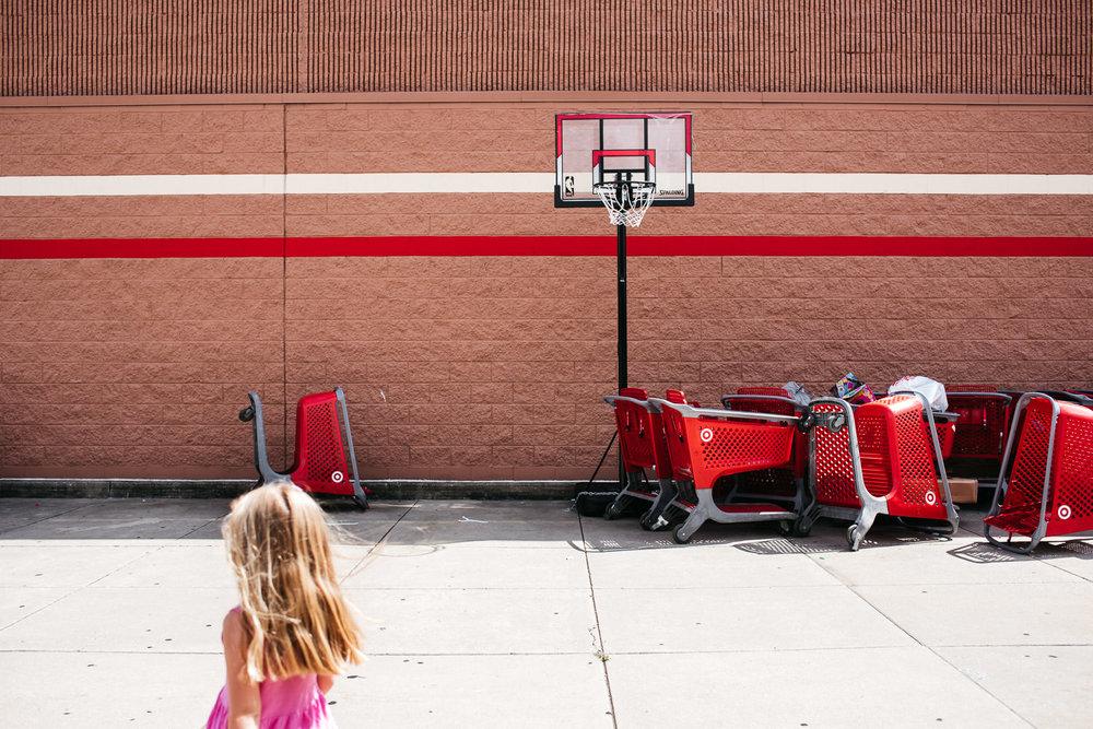 A little girl walks toward Target.